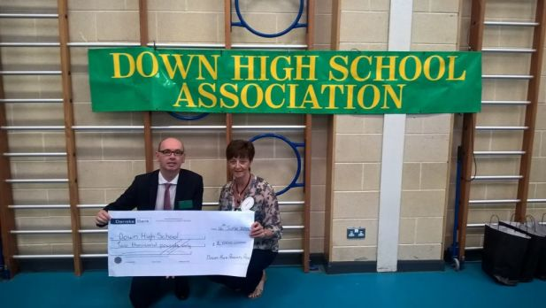 Mrs Claire Bain from the DHA hands over a cheque for £2000 to Mr Dawson